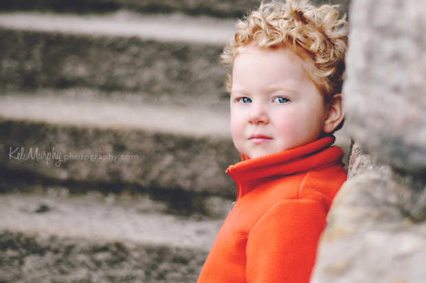 Kel Murphy Photography day 27 of 365 son leaning against stone wall with steps in the background