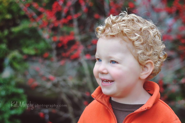 Kel Murphy Photography Day 38 of 365 son laughing in front of red berry bush