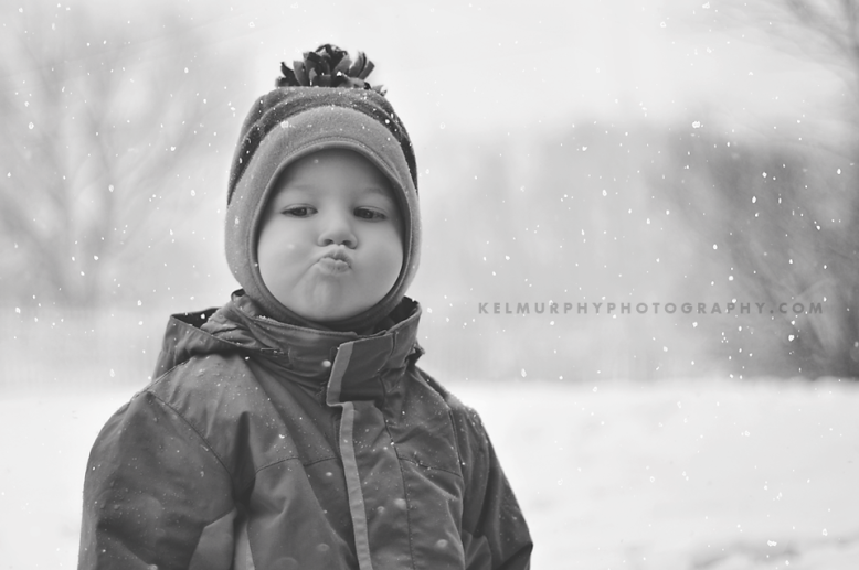 Kel Murphy Photography Day 45 of 365 BW of son standing in snow making funny face