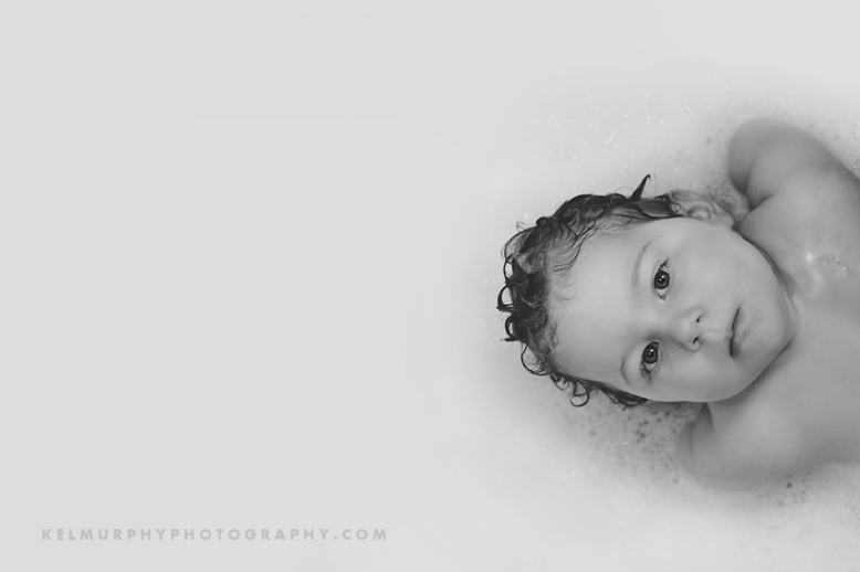 Kel Murphy Photography Day 55 of 365 son floating in bathtub just showing head and shoulders