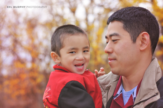 Chinese father and son smiling