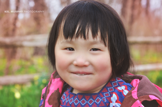 Cute little Chinese girl smiling