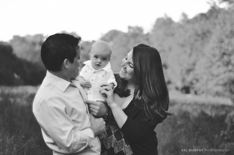 Lifestyle image of parents and 4 month old baby boy outside in the spring