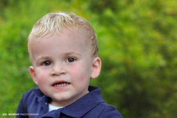 Blonde hair brown eyed little boy smiling