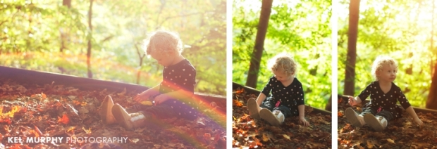Two year old little girl with curly blonde hair outside in the fall rainbow sunflare