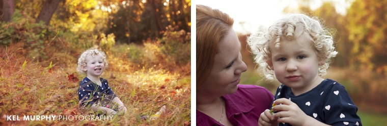 Two year old little girl with curly blonde hair outside in the fall with Mommy