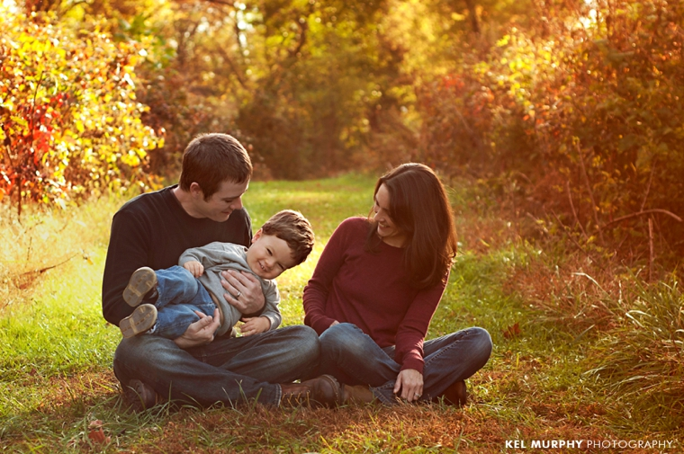 Kel-Murphy-Photography-Philadelphia-Child-Photographer-Montgomery-County-Bucks-County-Family-Families-Children-High-School-Senior-Portraits-family-of-three-cuddling-laughing-sitting-fall
