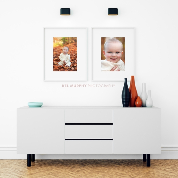 Custom home decor white matted Framed photos on white wall in front of hallway table by Kel Murphy Photography in Philadelphia