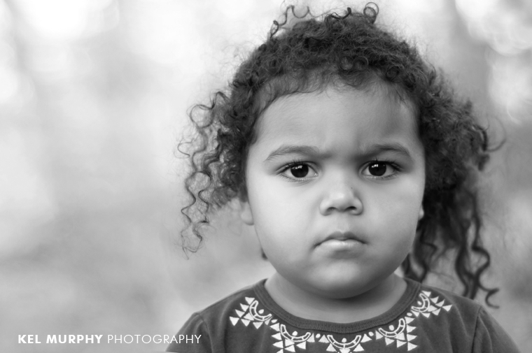 Grumpy little girl three year old funny face photo shoot session by Kel Murphy Photography