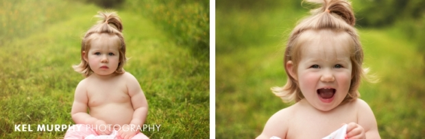 2 year old little girl half pony tail no shirt sitting outside spring by Kel Murphy Photography in Philadelphia